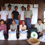 Providing the rice seed to some beneficiaries at Chork Char