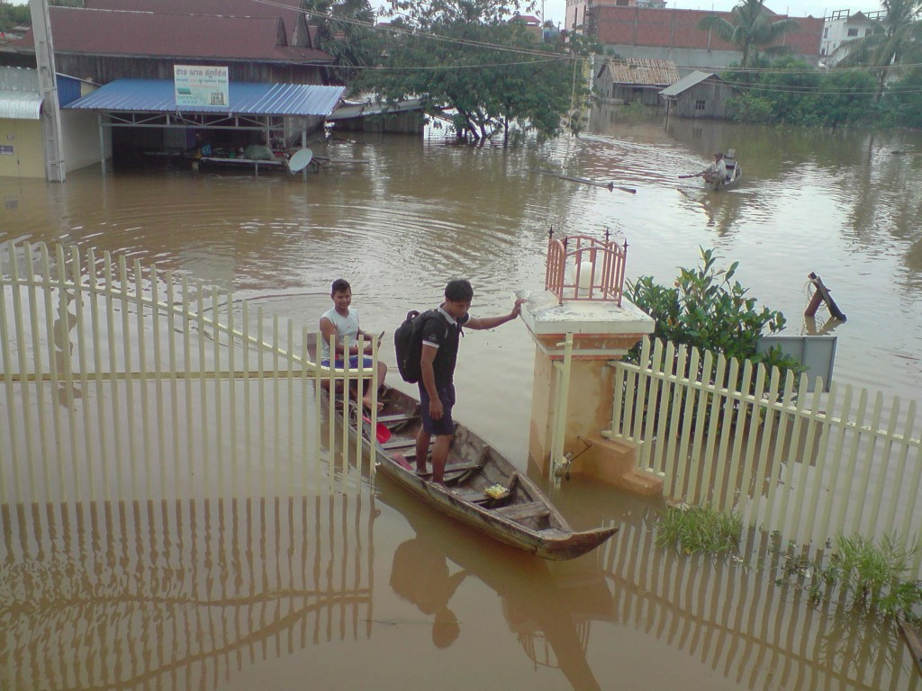 Our team arriving at our Kratie head office by boat.