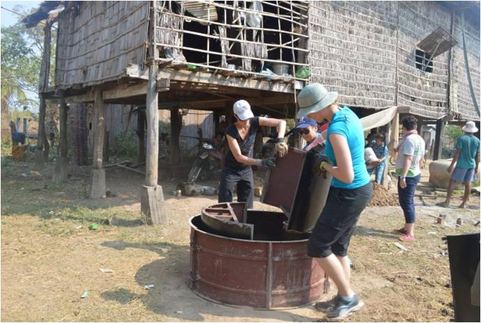 Tourists building a rainwater collector for a local family