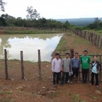 CRDT's staff and pond user committees in front of the pond in Gartie, Mondulkiri