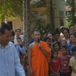 Monk leading traditional game during khmer new year in a community