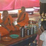 CRDT Business team offering foods to monks