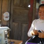 khmer woman stung treng tailoring sewing machine smiling